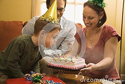 Boy with birthday cake.