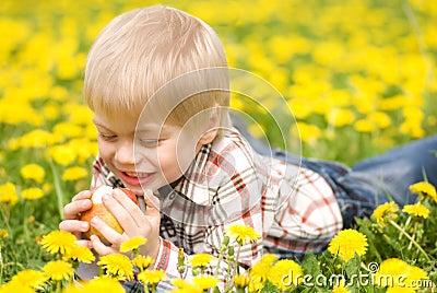 The boy bites off an apple