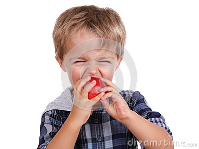 Boy biting a red apple