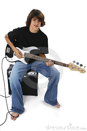 Boy With Black And White Bass Guitar Sitting On Amp