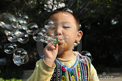 A boy blowing bubbles