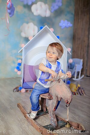 Boy In Blue And White Crew Neck T Shirt Riding On Wooden Rocking Moose Free Public Domain Cc0 Image
