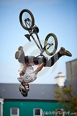 Boy on a bmx/mountain bike jumping Editorial Stock Photo