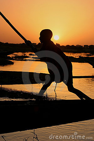 Boy on a boat on the Niger river
