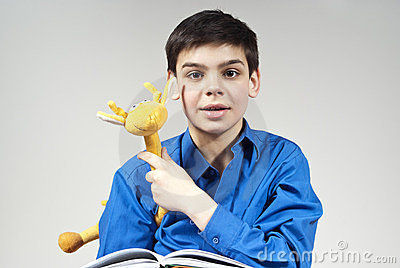 Boy with a book and toy
