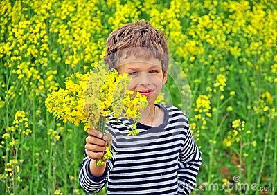 Boy with a bouquet of wildflowers