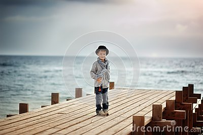 Boy on the bridge at the sea
