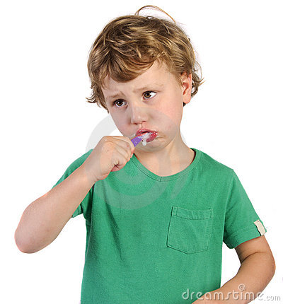 Boy brushing his teeth