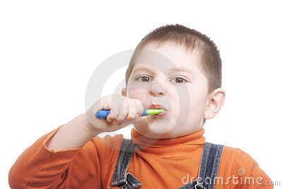 Boy brushing teeth with effort
