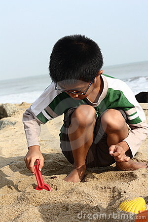 Boy Building Sand Castle