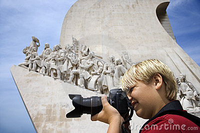 Boy with camera at monument in Portugal. Editorial Image
