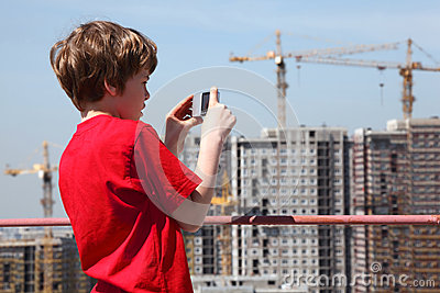 Boy with camera photo construction