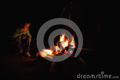Boy camp fire
