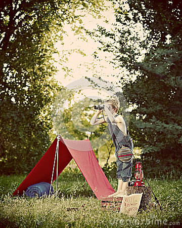 Boy camping in countryside