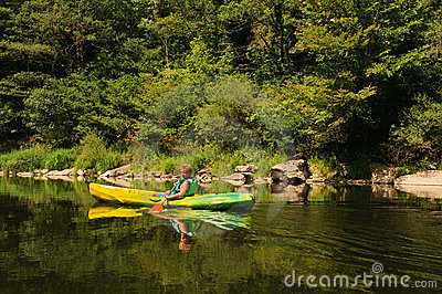 Boy canoeing on river