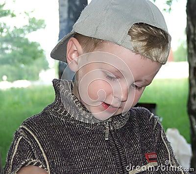 The boy in a cap.