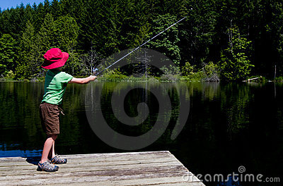 Boy casting fishing line