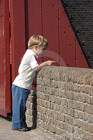 Boy at castle wall
