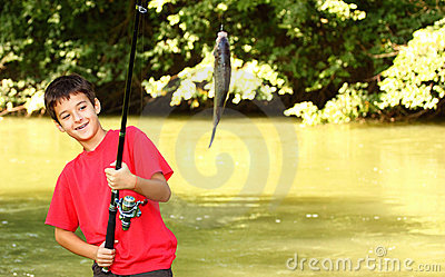 A boy catch a fish