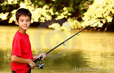 A boy catching fish