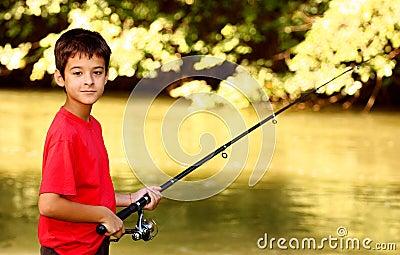 A boy catching fish
