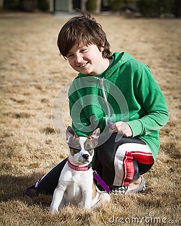 Boy with Cattle Dog / Boxer Hybrid Puppy
