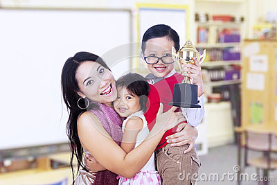 Boy champion and family in classroom