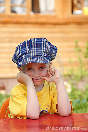 Boy in checkered blue cap