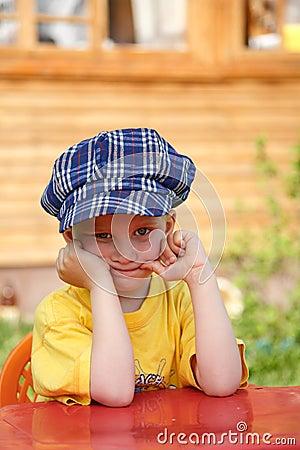 Boy in checkered blue cap