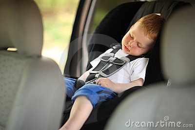Boy in child car seat