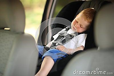 Boy in child car seat