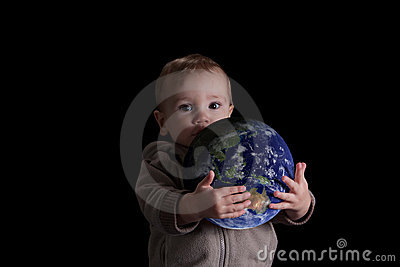Boy child holding world