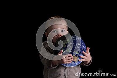 Boy child holding world