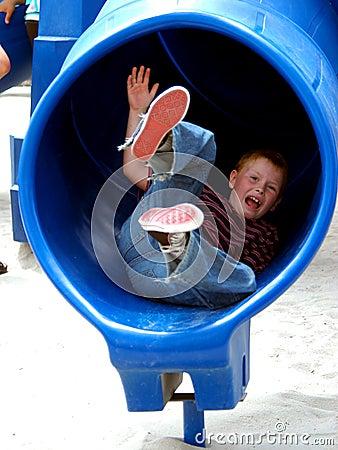 Free Boy Child In Tube Slide Stock Images - 151844