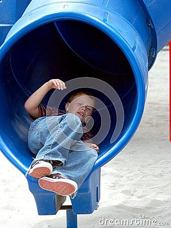 Free Boy Child In Tube Slide Royalty Free Stock Photo - 151845