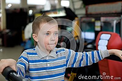 Boy in the children s amusement arcade