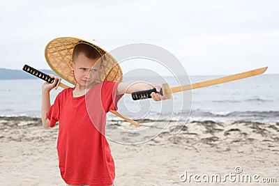 Boy with children samurai swords