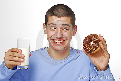 Boy with a chocolate donuts.