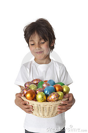 Boy with chocolate Easter eggs