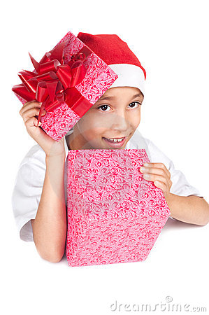 Boy in christmas red hat holding a gift box