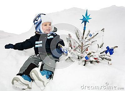 Boy and the christmas tree