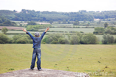 Boy at classic England landscape