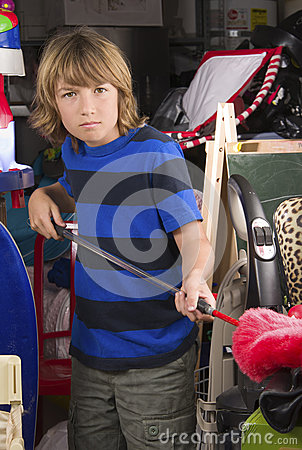 Free Boy Cleaning The Garage Stock Images - 30187944