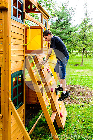 Free Boy Climbing Rock Wall Playhouse Stock Images - 55230454