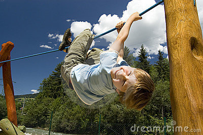 Boy On Climbing Rope