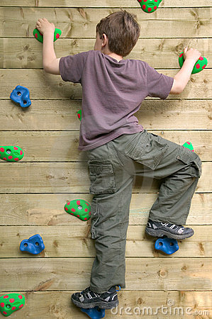 Boy on a climbing wall