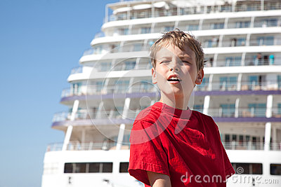 Boy closed eyes against background ship