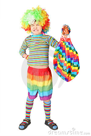 Boy in clown dress with multicolored baloon