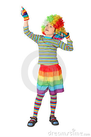 Boy in clown dress pointing at side isolated