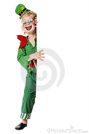 Boy in clown dress standing behind a board